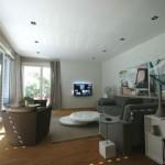 Modernes Wohnzimmer mit Couchgarnitur und Jalousien