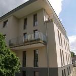 Modernes Mehrfamilienhaus Kosima in Grau